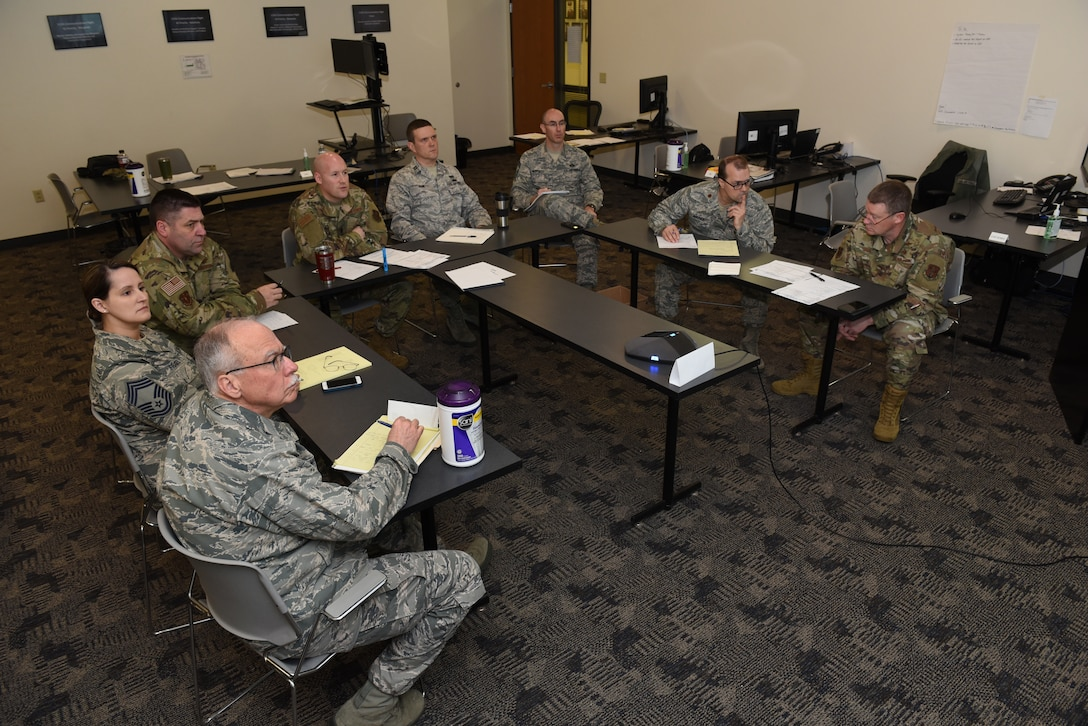 A crisis action team comprised of key members of the Wisconsin Air National Guard's 115th Fighter Wing engage in a conference call at Truax Field in Madison, Wisconsin, March 20, 2020. The 115th FW initiated a daily CAT operation on March 18 in preparation to support local authorities in the response to the COVID-19 pandemic. (U.S. Air National Guard photo by Master Sgt. Paul Gorman)