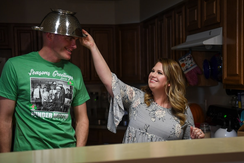 And man and woman stand near a sink