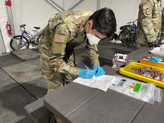 Nevada National Guardsmen conducted a sample collection site for COVID-19 testing in downtown Reno Jan. 7, 2021, after Washoe County Health District officials noticed an uptick in cases among homeless people in shelters.