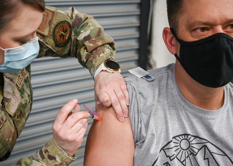 Aaron Butler, 775th Civil Engineering Squadron, receives his COVID-19 vaccination.