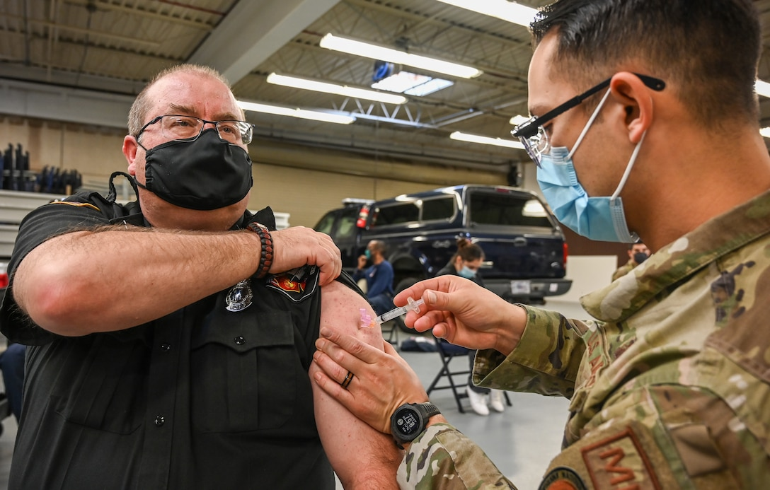 Virgil Jones, 775th Civil Engineer Squadron fire chief, receives his COVID-19 vaccination.
