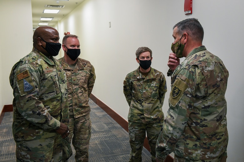 From left to right, U.S. Air Force Col. Devin Pepper, Buckley Garrison commander, U.S. Air Force Col. Brian Chellgren, 460th Mission Support Group commander, U.S. Air Force Col. Shannon Phares, 460th Medical Group commander, and U.S. Army Gen. James Dickinson, U.S. Space Command commander, are introduced following a mission brief in the Buckley Garrison headquarters building on Buckley Air Force Base, Colo., Jan. 7, 2021.