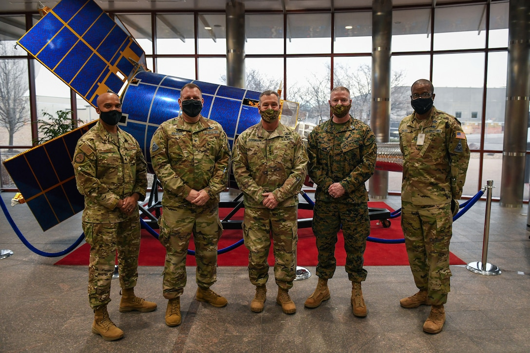 From left to right, U.S. Air Force Lt. Col. Trevor Hollis, Space Delta 4 deputy commander, U.S. Space Force Col. Richard Bourquin, DEL 4 commander, U.S. Army Gen. James Dickinson, U.S. Space Command commander, U.S. Marine Corps Master Gunnery Sgt. Scott H. Stalker, USSPACECOM senior enlisted leader, and U.S. Space Force Chief Master Sgt. Willie Frazier, DEL 4 senior enlisted leader, pose for a group photo in the Mission Control Station lobby on Buckley Air Force Base, Colo., Jan. 7, 2021.