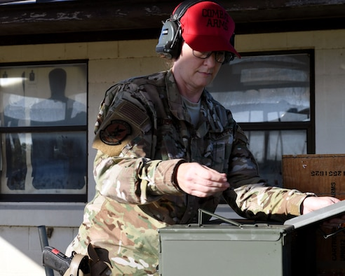 Staff Sgt. Tina Ryder, an Air National Guard Combat Arms instructor from the 149th Security Forces Squadron, prepares for weapons qualification training at a firing range on Joint Base San Antonio's Medina Annex May 27, 2020.