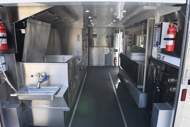 The 145th Airlift Wing Force Support Squadron's new Disaster Relief Mobile Kitchen Trailer (DRMKT) is prepped for use while outside of the Dining Facility at North Carolina Air National Guard Base, Charlotte Douglas International Airport, December 9, 2020. The 145th Airlift Wing is the second unit to receive the DRMKT which can be used to provide up to 960 meals per hour to locations affected by natural disasters.