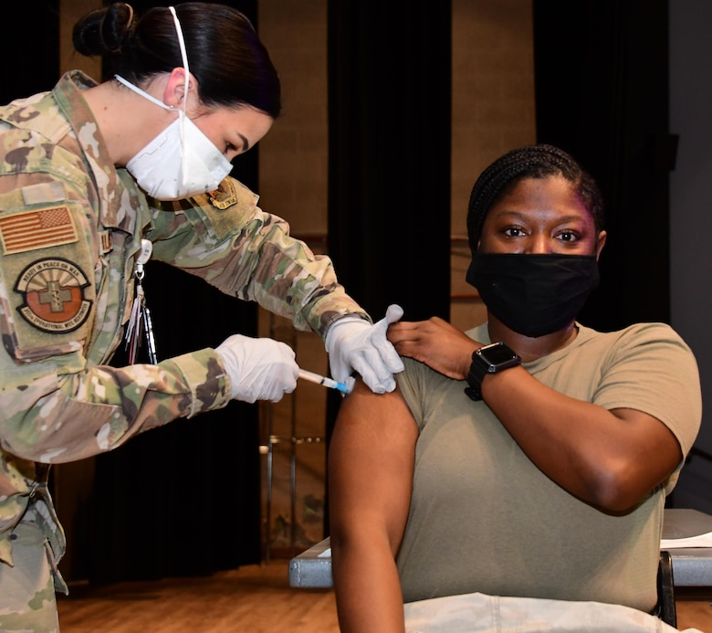 A picture of an Airman receiving the COVID-19 vaccine.