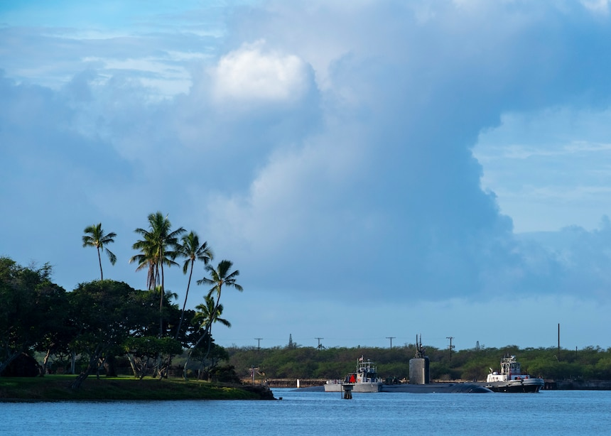 PEARL HARBOR, Hawaii (Dec. 15, 2020) - The Los Angeles-class fast-attack submarine USS Topeka (SSN 754) arrives in Pearl Harbor, Hawaii, after completing a change of homeport from Guam, Dec. 15. Topeka's ability to support a multitude of missions, including anti-submarine warfare, anti-surface ship warfare, strike warfare, surveillance and reconnaissance, has made Topeka one of the most capable submarines in the world. (U.S. Navy Photo by Chief Mass Communication Specialist Amanda R. Gray/Released)