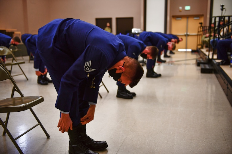U.S. Air Force 66th Training Squadron Survival, Evasion, Resistance and Escape Specialist Course graduates blouse their boots upon completing the SERE Specialist Apprentice Course at Fairchild Air Force Base, Washington, January 8, 2021. Prior to becoming SERE specialists, candidates go through a strenuous six-month training pipeline where normal attrition rates average about 50 percent due to the rigorous nature of the training. (U.S. Air Force photo by Senior Airman Ryan Gomez)