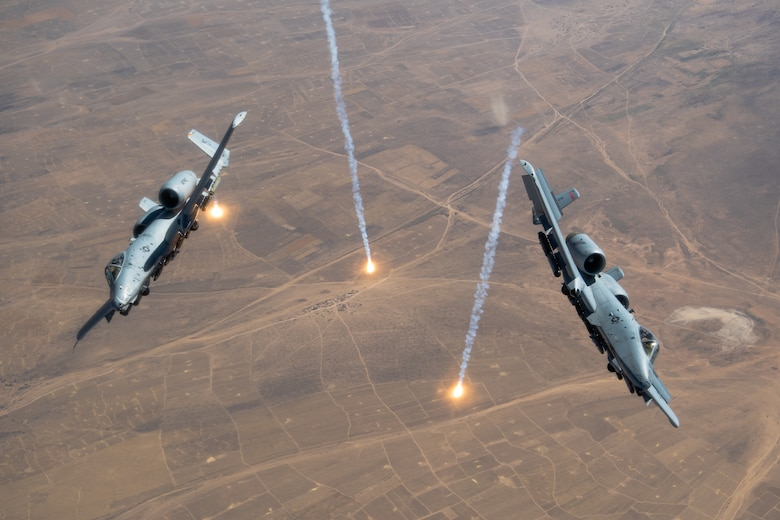 A U.S. Air Force KC-135 Stratotanker refuels A-10 Thunderbolts.