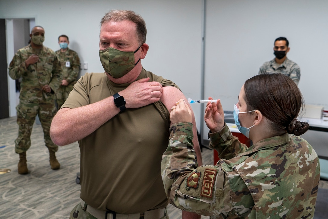 Air Force Reserve Senior Airman Megan Stahl, right, a medical technician with the 78th Healthcare Operations Squadron, administers the COVID-19 vaccine to Lt. Gen. Richard Scobee, chief of the Air Force Reserve and commander of Air Force Reserve Command, Jan. 8th, 2021 at Robins Air Force Base, Ga.