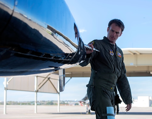 U. S. Air Force Lt. Col. Andrew Williams, 415th Flight Test Flight commander, inspects a T-38 before its test flight at Joint Base San Antonio-Randolph Dec. 1, 2020.
