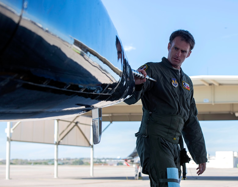 U. S. Air Force Lt. Col. Andrew Williams, 415th Flight Test Flight commander, inspects a T-38 before its test flight at Joint Base San Antonio-Randolph Dec. 1, 2020.
