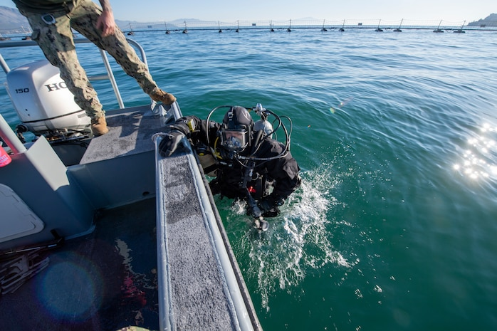 Underwater Construction Team (UCT) 1, from Virginia Beach, VA, move the spill containment barrier while utilizing the Norbit Multi-beam to conduct hydro-graphic survey in Gaeta, Italy, Dec. 15, 2020.