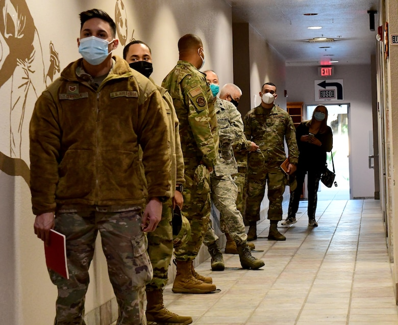 Members of the 926th Wing wait to receive their first dose of the COVID-19 vaccination during the Unit Training Assembly, Jan. 9, at Nellis Air Force Base, Nevada. (U.S. Air Force Photo by Staff Sgt. Lorna Booze)