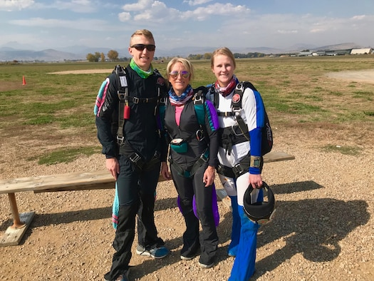 Brig. Gen. Kathleen Flarity, mobilization assistant to the command surgeon, Air Mobility Command (center), poses for a photo with her son, Patrick, and daughter, Tori, before a skydiving jump.