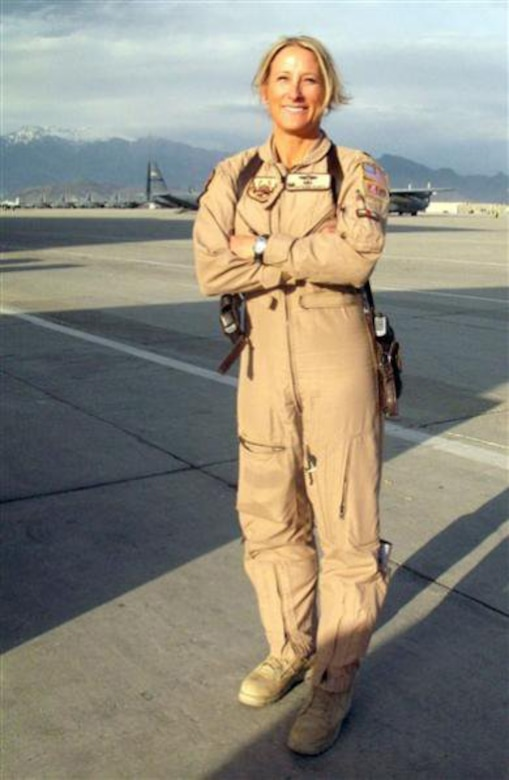 Col. Kathleen Flarity, 34th Aeromedical Evacuation Squadron commander, stands on the flightline of an undisclosed location in South Asia in May 2011.