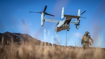 Members of the Japan Ground Self-Defense Force fast rope out of an U.S. Marine Corps MV-22B Osprey