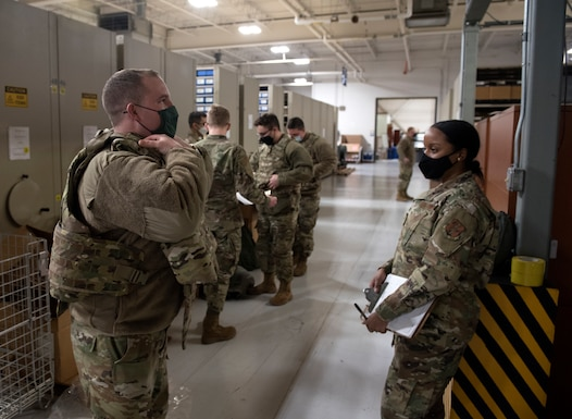 Capt. Reilly Nuckel, commander of the 108th Wing's vehicle management flight, dons protective gear Jan. 9, 2021, at Joint Base McGuire-Dix-Lakehurst N.J. National Guard Soldiers and Airmen from several states have traveled to the National Capital Region to provide civil disturbance support to federal and district authorities.