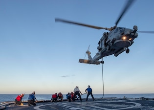 USS Bunker Hill (CG 52) conducts helicopter in-flight refueling training.