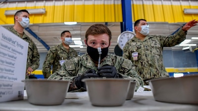 Sailors prepare COVID-19 vaccines at Naval Base San Diego.