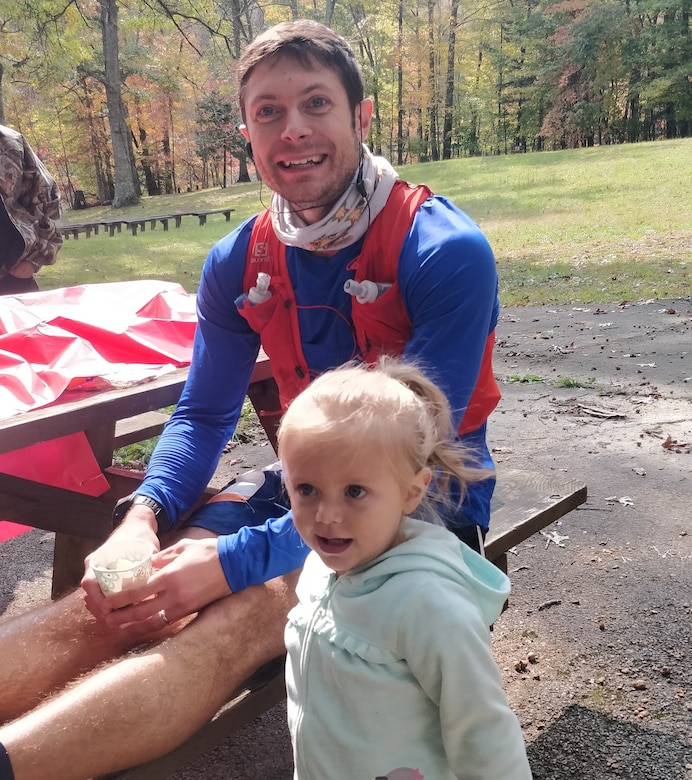 Capt. Kyle Imhoff takes a break during the race with is daughter.