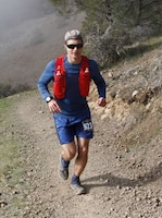 Capt. Kyle Imhoff runs a trail during a race.