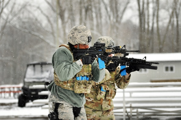445th Security Forces Squadron Airmen neutralize targets with simulated live rounds during shoot, move, communicate training, Feb. 8, 2020 at the Wright-Patterson Air Force Base Warfighter Training Center.