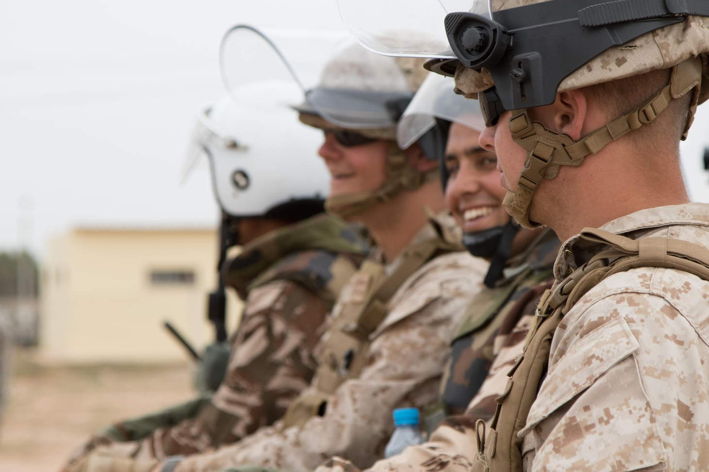 170424-A-UE565-0001 TIFNIT, Moroco (Apr. 24, 2017) Marine Company B, 4th Law Enforcement Battalion from Pittsburg, Pennsylvania, and Royal Moroccan Armed Forces enjoy a small break in crowd control training in Tifnit, Morocco, on April 24, 2017, during Exercise African Lion. Exercise African Lion is an annually scheduled, combined multilateral exercise designed to improve interoperability and mutual understanding of each nation's tactics, techniques and procedures. (U.S. Marine Corps photo by Sgt. Christopher Osburn/ Released)