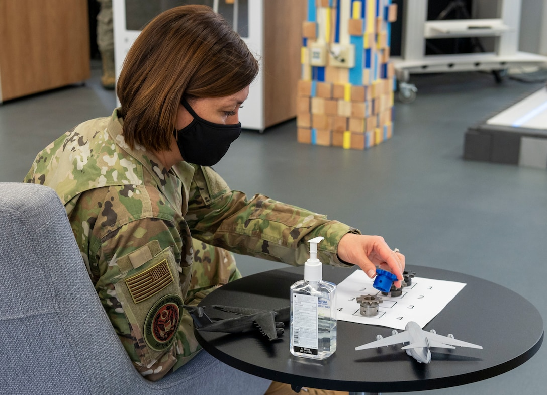 Chief Master Sgt. of the Air Force JoAnne S. Bass inspects a sprocket designed to solve a maintenance issue affecting refueling trucks Jan. 8, 2021, at the Bedrock innovation lab on Dover Air Force Base, Delaware. Designs like this are developed at Bedrock's facilities where Airmen are empowered to collaborate and innovate new technologies. (U.S. Air Force photo by Senior Airman Christopher Quail)