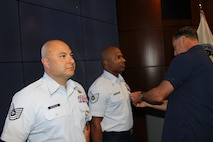 Pictured from left is Tech. Sgt. Edwin Lenis Gonzalez and Tech. Sgt. Jose Lopez Rodriguez received the Joint Service Achievement Medal from Coast Guard Rear Adm. Pat DeQuattro. (Courtesy photo)
