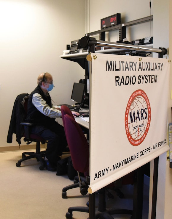Pete Baron, a volunteer Military Auxiliary Radio System (MARS) operator,conducts a radio check on October 17, 2020 at Hancock Field Air National Guard Base in Syracuse, New York.  MARS operators are civilian ham radio operators who volunteer to maintain shortwave radio sets for the military that can be used in emergencies. U.S. Air National Guard Photo by Airman Tiffany Scofield.
