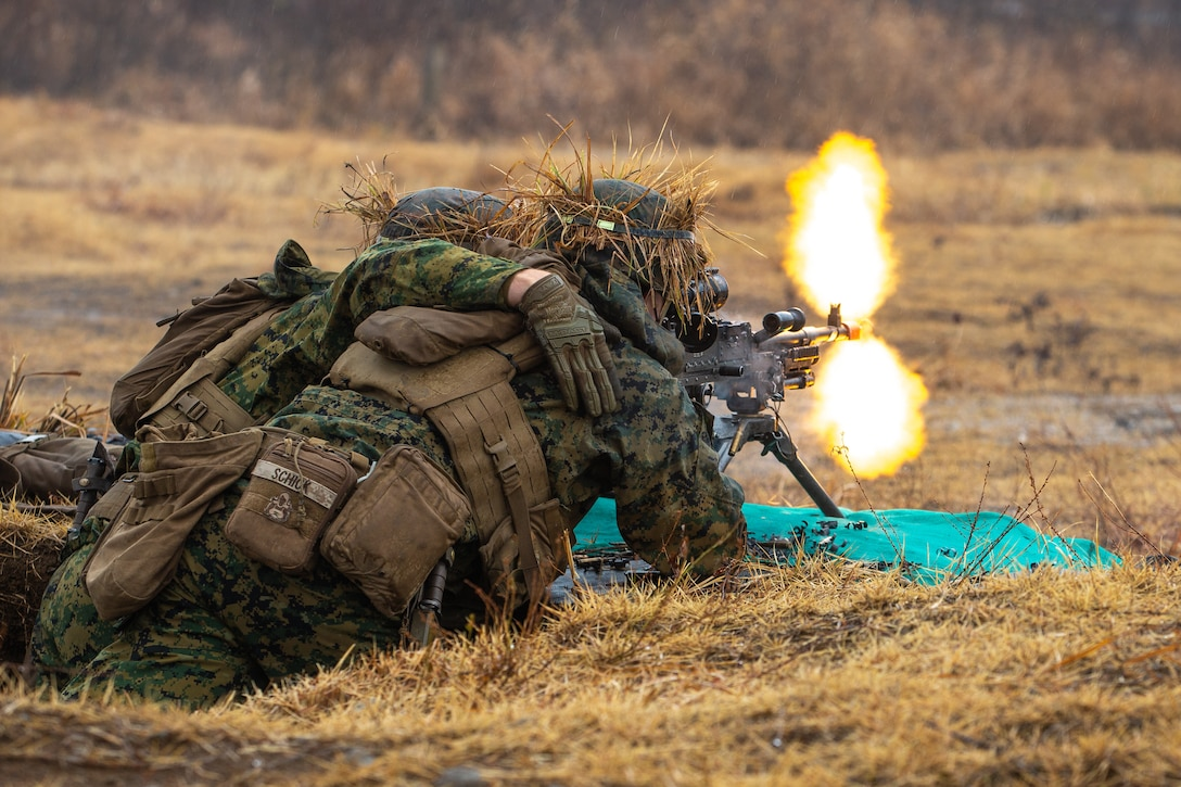 U.S. Marines lay down fire during a live-fire range in the Niigata Prefecture, Japan, Dec. 8.