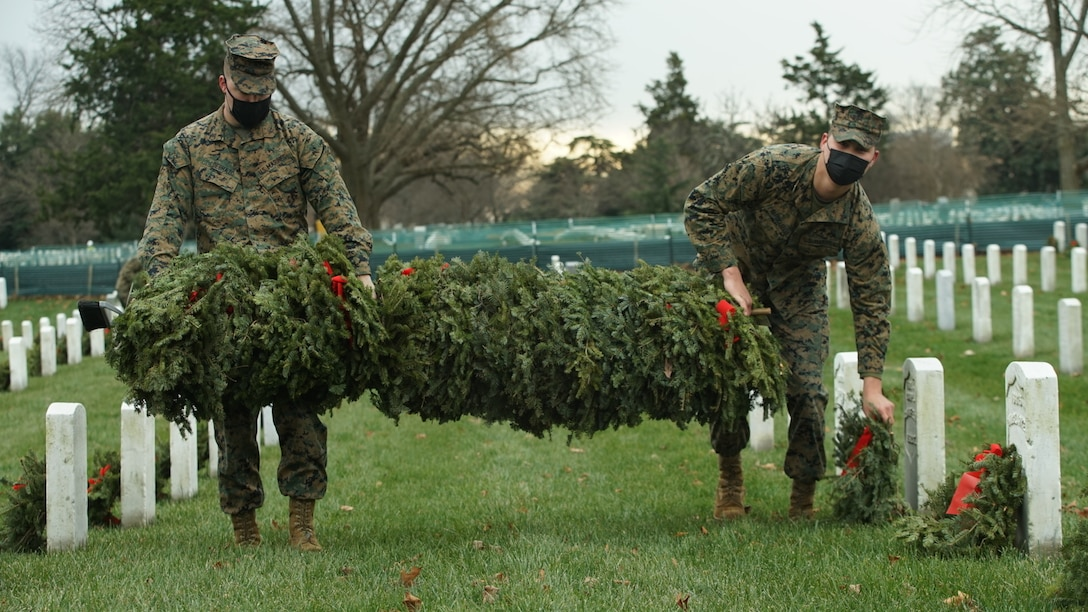 U.S. Marines join soldiers, sailors and airmen in picking up and disposing of wreaths at Arlington National Cemetery, Va. The cemetery was one of approximately 2,000 locations where wreaths were laid in December on headstones of veterans in the annual observance of their service and sacrifices. (U.S. Marine Corps photo by Lance Cpl. Morgan L. R. Burgess)