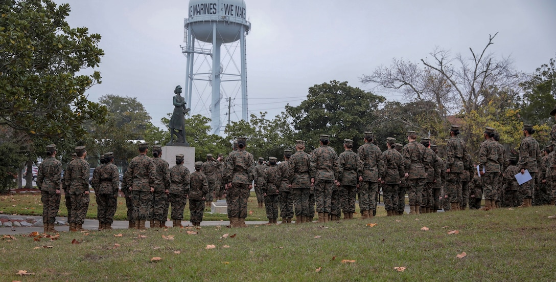 Marines with November Company, 4th Recruit Training Battalion, stand around the Molly Marine statue for an award ceremony on Marine Corps Recruit Depot Parris Island, S.C. Dec 16, 2020. The Molly Marine award is given to the Marine voted to best exemplify the core values of honor, courage, and commitment. (U.S. Marine Corps photo by Lance Cpl. Michelle Brudnicki)