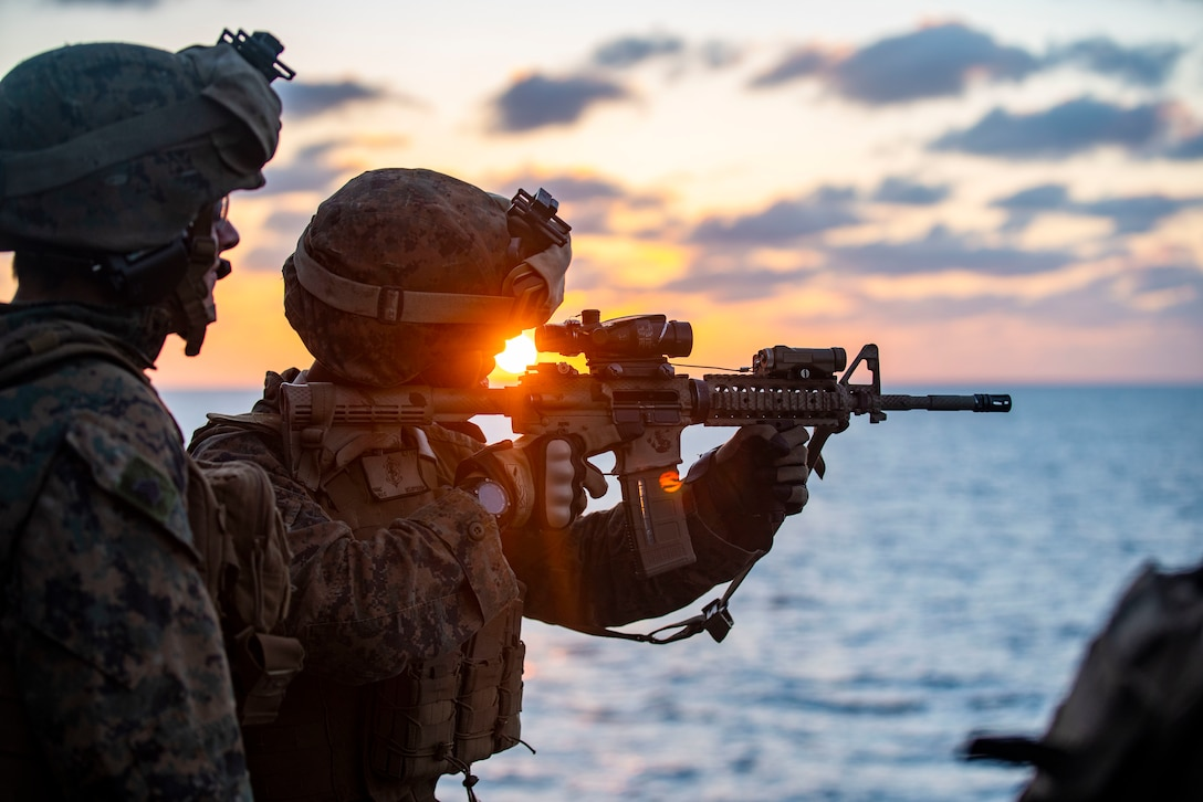 A U.S. Marine fires his M4 carbine during a combat marksmanship training event aboard the amphibious assault ship USS Makin Island (LHD 8), Dec. 19.