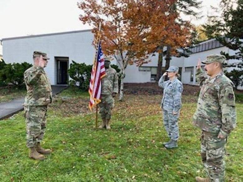 Commander re-enlists two Reserve Citizen Airmen