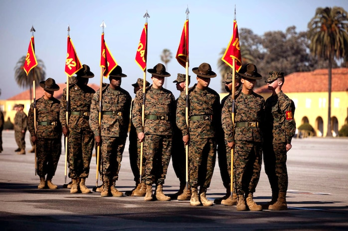 Drill instructors with Charlie Company, 1st Recruit Training Battalion, exchange guidons during a graduation ceremony at Marine Corps Recruit Depot, San Diego, Jan. 8, 2021.