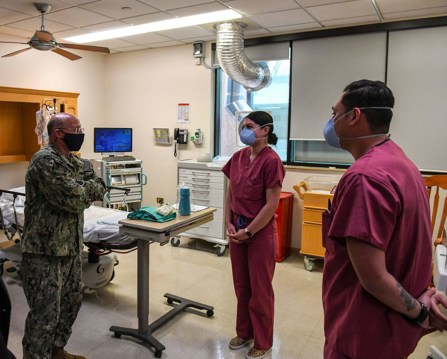 Adm. Mike Gilday, Chief of Naval Operations, left, speaks with Corpsmen assigned to the Multi Service Ward at U.S. Naval Hospital Naples, Italy, about negative-pressure rooms used to treat potential coronavirus (COVID-19) patients at the hospital, Jan. 11, 2021. USNH Naples, the largest naval hospital in Europe, serves a diverse population of over 9,800 beneficiaries. Over 500 staff members at the main hospital, branch health clinic, and Navy Liaison Detachment in Landstuhl, Germany work tirelessly to keep warfighters in the fight and provide care for their families. (U.S. Navy photo by Mass Communication Specialist 3rd Class Trey Fowler/ Released)