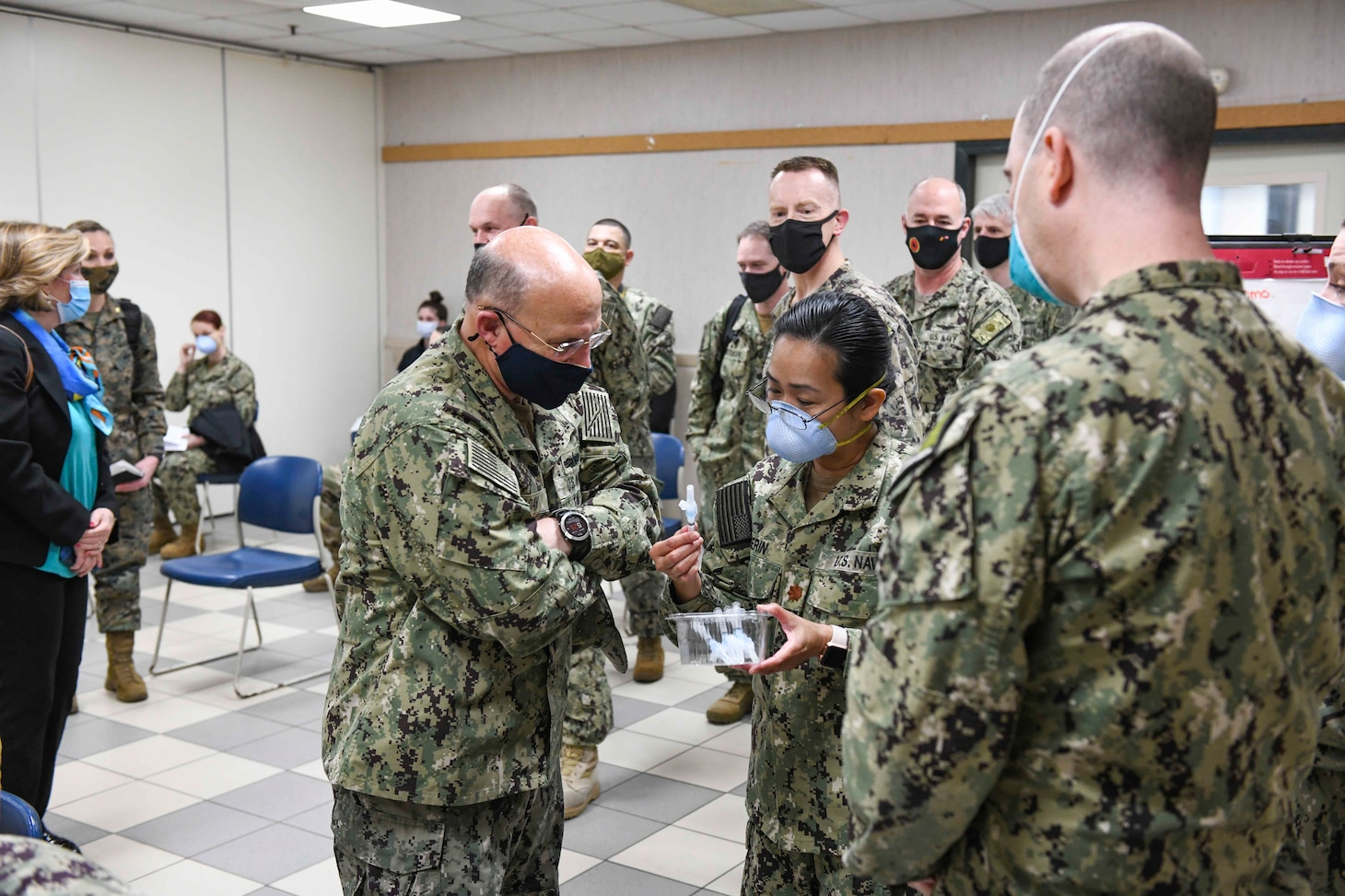 NAVAL SUPPORT ACTIVITY NAPLES, Italy (Jan. 7, 2021) Adm. Michael Gilday, Chief of Naval Operations, left, observes the COVID-19 vaccination site at Naval Support Activity Naples Support Site, Italy, Jan. 7, 2021. U.S. Naval Forces Europe and Africa, headquartered in Naples, Italy, conducts the full spectrum of joint and naval operations, often in concert with allied and interagency partners, in order to advance U.S. national interests, security and stability in Europe and Africa. (U.S. Navy photo by Mass Communication Specialist 3rd Class Trey Fowler/ Released)