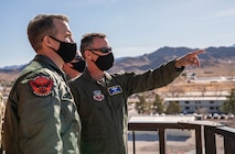 Col. Stephen Jones, left, 432nd Wing/432nd Air Expeditionary Wing commander, surveys the base from an air traffic control tower with Maj. Gen. Chad Franks, right, Fifteenth Air Force commander.
