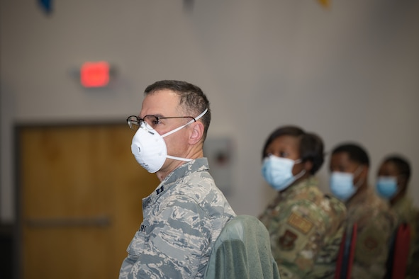 Photo of Airman with mask looking to his left