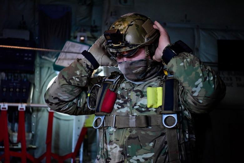 Soldier securing his helmet