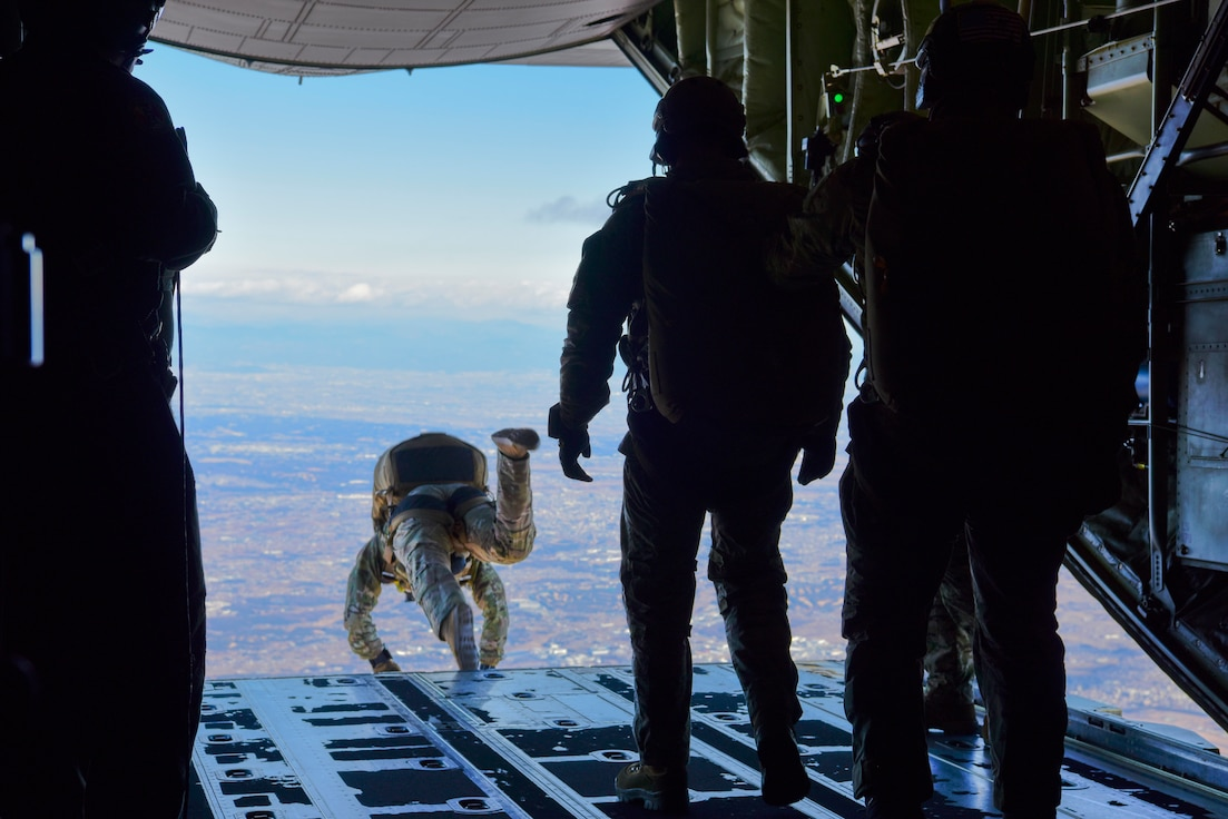 Airmen and Soldiers jump out of C-130J Super Hercules