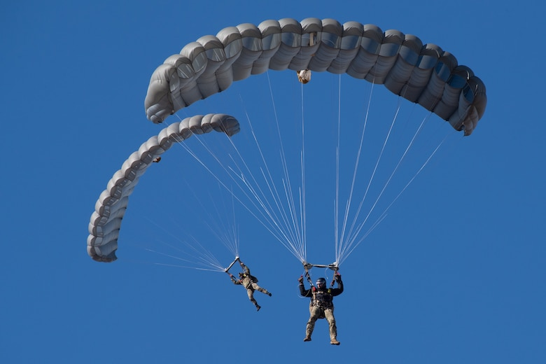 Two soldiers parachuting