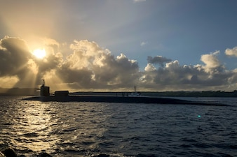 Sailors assigned to the Gold crew of the Ohio-class guided-missile submarine USS Ohio (SSGN 726) transit Apra Harbor during a scheduled evolution in Guam.