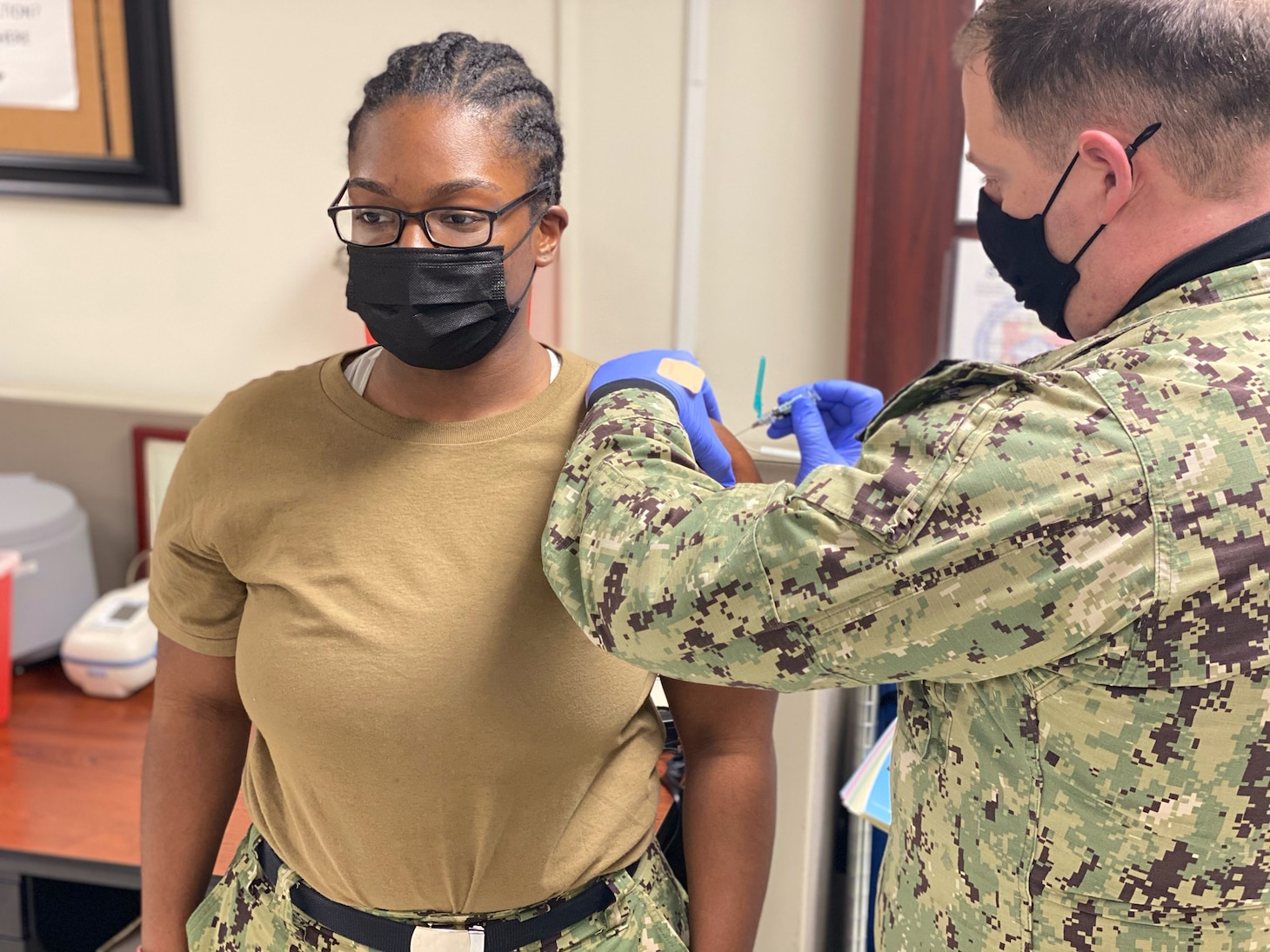 LITTLE ROCK, Arkansas (Jan. 9, 2021) - Logistics Specialist 3rd Class Jhashaira Farmer, a Selected Reservist (SELRES) Sailor, receives the influenza vaccination administered by Hospital Corpsman 2nd Class Randall Busby, a Medical department representative at Navy Operations Support Center Little Rock during the command's first drill weekend of the year. NOSC Little Rock coordinated mission-essential training and readiness events for more than 148 SELRES Sailors during the drill weekend, which was tailored to provide a more streamlined approach to warfighting readiness in accordance with the Chief of Navy Reserve's recently released Fighting Instructions. (U.S. Navy photo taken by Electronics Technician 1st Class Stephen Landry/Released)
