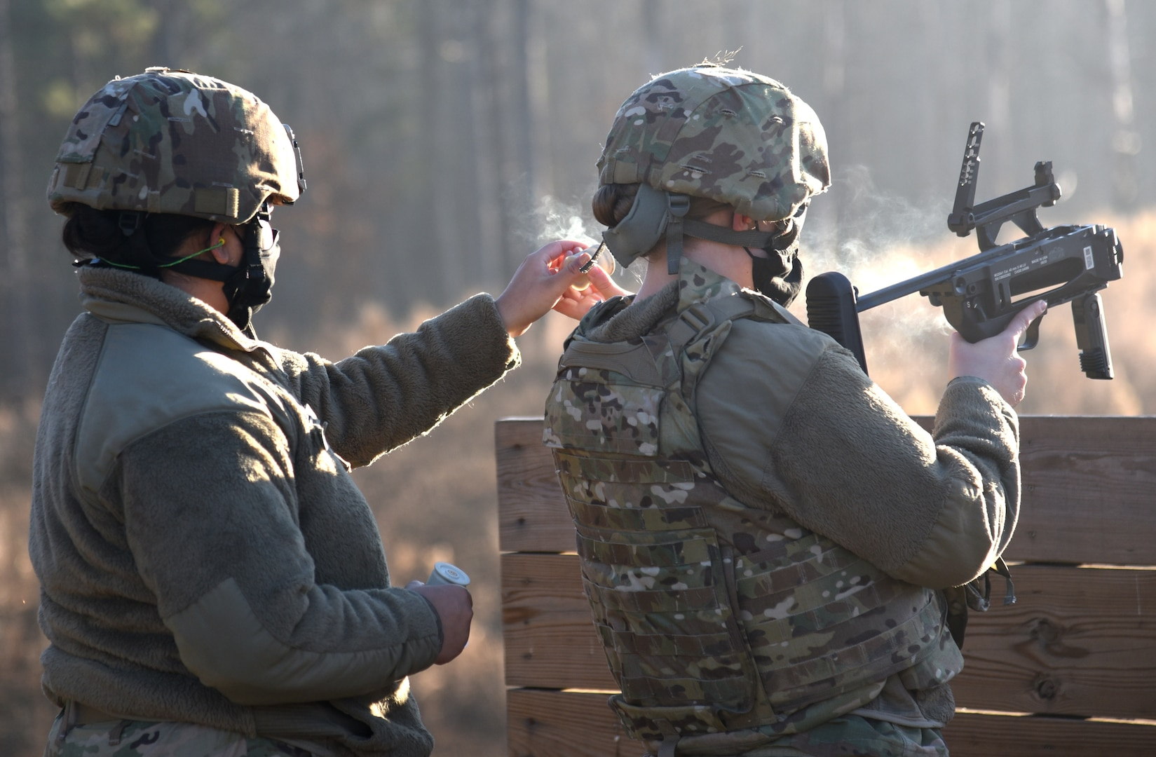 Virginia National Guard Soldiers assigned to the Virginia Beach-based 329th Regional Support Group conduct a familiarization live fire with the M320A1 grenade launcher Dec. 11, 2020, at Fort Pickett, Virginia.