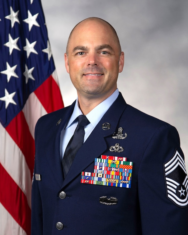 Chief Master Sgt. Jeremiah Grisham, 436th Mission Support Group superintendent, poses for his official head and shoulders photo June 9, 2020, at Dover Air Force Base, Del. Grisham provides guidance, direction and leadership to over 1,500 Airmen and Department of Defense/Non-appropriated Fund civilians from six squadrons. He leads an enlisted leadership team comprised of six superintendents and five First Sergeants in identifying and addressing health, morale and welfare concerns affecting the quality of life of Airmen assigned to the group. He serves as advisor to the group commander on enlisted issues, which include matters of professional development, good order and discipline and effective manpower utilization. (U.S. Air Force photo by Senior Airman Christopher Quail)