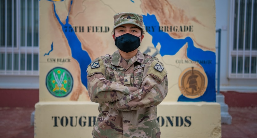Sgt. Brandy Lopez, an Information Technology (IT) Specialist assigned to 75th Field Artillery Brigade of Fort Sill, OK, poses in front of the brigade's T-wall after being promoted to the rank of Sergeant on December 28, 2020, while deployed to the Middle East in support of Operation Spartan Shield. For the past nine months, Lopez had provided countless hours of IT support and troubleshooting to every Diamond Brigade Soldier deployed to the Middle East and was selected as the only Specialist to be promoted through Battle Field Promotion within Area Support Group - Jordan. (U.S. Army photo by Sgt. Dustin D. Biven / 75th Field Artillery Brigade)