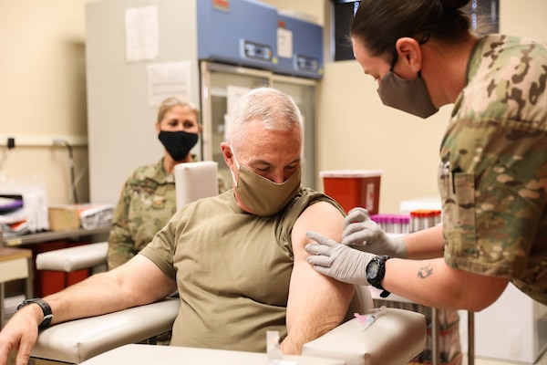 Kentucky Adjutant General Haldane B. Lamberton gets his COVID-19 vaccine administered by Kentucky National Guard technician Sgt. Jamie Pungirum Jan. 11, 2020, at the medical detachment on Boone National Guard Center, Frankfort, Ky.